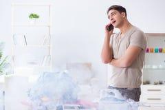 The inattentive husband burning clothing while ironing. Inattentive husband burning clothing while ironing Royalty Free Stock Photography