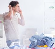 The inattentive husband burning clothing while ironing