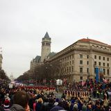 2017 Inauguration Parade. Trump tower stands above President Trump`s 2017 inauguration parade with the Capitol building in the background and colonial dressed Royalty Free Stock Photo