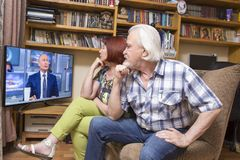 Inauguration of the Russian president. ULAN - UDE, RUSSIA - June, 09.2018: Russian pensioners watch TV on NTV channel `The direct line of Russian President stock photos
