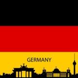 Inbandieri i colori con la siluetta dell'orizzonte dei colori della Germania Fotografia Stock Libera da Diritti