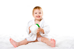 Inbathrobe del bebé de la belleza con el tarro plástico imagen de archivo