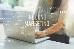 Inbound marketing with woman using laptop. Inbound marketing with woman using her laptop in her home office royalty free stock photo