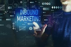 Inbound marketing with young man. On a dark background royalty free stock images