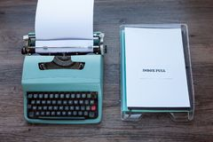 Inbox Full - typewriter with plastic filing tray. Inbox Full - Old fashioned typewriter with plastic filing tray royalty free stock images