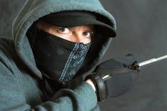 Inbreker Breaking In, Linkerkant stock foto's