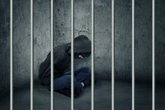 Inbreker in gevangenis royalty-vrije stock foto