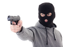 Inbrottstjuv eller terrorist i maskeringen som siktar med vapnet som isoleras på vit Arkivfoton