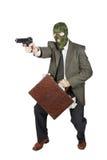 Inbrottstjuv med vapnet och en resväska mycket av pengar Royaltyfri Bild