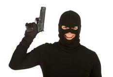 Inbrottstjuv: Ond inbrottstjuv med vapnet Arkivbild