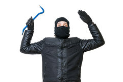 Inbrottstjuven eller tjuven sätter upp händer Den arresterade rånaren ger upp Arkivbild