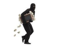Inbrottstjuvspring med en påse som är full av pengar fotografering för bildbyråer