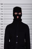 InbrottstjuvStanding Against Police Lineup fotografering för bildbyråer