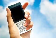 inbunden mobil telefonsky Arkivbilder