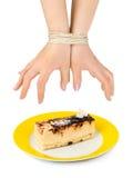 inbundna cakehänder arkivbild