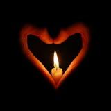 Incêndio da vela nas mãos heart-shaped fotografia de stock royalty free