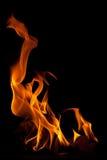 Incêndio em um fundo preto fotos de stock royalty free