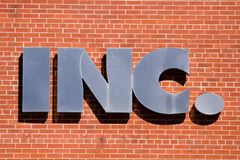 Inc sign. INC. sign on a brick wall Royalty Free Stock Photography