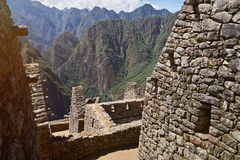 Inca ancient Machu Picchu town. In Peru. Old houses from stone bricks royalty free stock photos