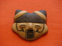 Inca cat mask. The Incas ruled the largest native empire in South American history and produced many fine textiles, pottery, and metalwork stock photos