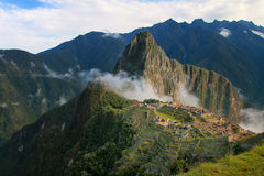 Inca citadel Machu Picchu with morning fog, Peru. In 2007 Machu Picchu was voted one of the New Seven Wonders of the World royalty free stock photo