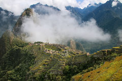 Inca citadel Machu Picchu with morning fog, Peru. In 2007 Machu Picchu was voted one of the New Seven Wonders of the World royalty free stock images