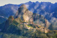 Inca citadel Machu Picchu with morning fog, Peru. In 2007 Machu Picchu was voted one of the New Seven Wonders of the World stock photography
