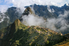 Inca citadel Machu Picchu with morning fog, Peru. In 2007 Machu Picchu was voted one of the New Seven Wonders of the World royalty free stock photos