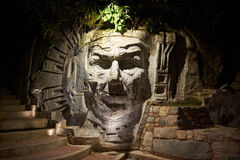 Inca face statue. Agua Calientes, Peru - January 4, 2017: Illuminated inca face statue in Agua Calientes city Peru stock photos