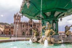 Inca Fountain and Cathedral at Plaza de Armas - Cusco, Peru. Inca Fountain and Cathedral at Plaza de Armas in Cusco, Peru Stock Image
