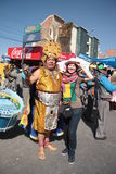 Inca man with a happy tourist girl at parade, Bolivia Royalty Free Stock Images