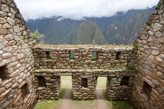 Inca Ruins. Doors to mountain view in Machu Picchu ruins Royalty Free Stock Images