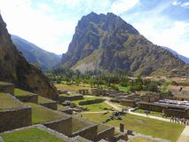 Inca ruins in Andes Mountains. Inca terraces and ruins in the town of Ollantaytambo in the Andes Mountains in central Peru Royalty Free Stock Photo