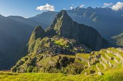 Inca Ruins av Machu Picchu på solnedgången, Peru royaltyfri fotografi