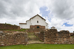 Inca ruins and church in the village of Chinchero, in Peru. Catholic church built over ancient Inca stone walls in the the village of Chinchero, in Peru Stock Images