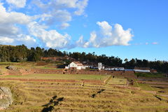 Inca ruins and the colonial town of Chinchero, near to Cusco, Peru. Picture showing the archeological inca site of Chinchero, and the new colonial town over it stock photos