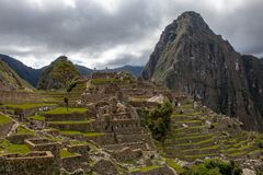 The Inca Ruins at Machu Picchu. The stunning Inca ruins at Machu Picchu, Peru with an assortment of intact stone buildings built on multiple terraces royalty free stock photos