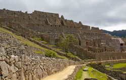 The Inca Ruins at Machu Picchu. The stunning Inca ruins at Machu Picchu, Peru with an assortment of intact stone buildings built on multiple terraces royalty free stock photo