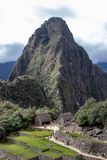 The Inca Ruins at Machu Picchu. The stunning Inca ruins at Machu Picchu, Peru with an assortment of intact stone buildings built on multiple terraces stock photography