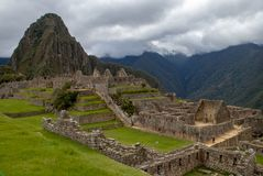 The Inca Ruins at Machu Picchu. The stunning Inca ruins at Machu Picchu, Peru with an assortment of intact stone buildings built on multiple terraces royalty free stock photography
