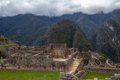 The Inca Ruins at Machu Picchu. The stunning Inca ruins at Machu Picchu, Peru with an assortment of intact stone buildings built on multiple terraces stock image