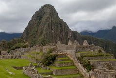 The Inca Ruins at Machu Picchu. The stunning Inca ruins at Machu Picchu, Peru with an assortment of intact stone buildings built on multiple terraces stock images