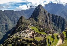 The Inca Ruins at Machu Picchu. The stunning Inca ruins at Machu Picchu, Peru with an assortment of intact stone buildings built on multiple terraces stock photo