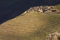 Inca ruins and terraces at Qantus Raqay - Peru Stock Photo