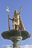 Inca statue over fountain Stock Photos