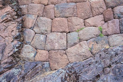 Inca stone wall on bedrock in Pisac, Peru Royalty Free Stock Photography