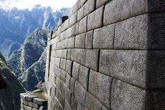 Inca Stone Wall With Mountains In Background Machu Picchu Peru. Stone Wall Detail Machu Picchu Peru South America Inca Ruins Architecture With Mountains And stock photo