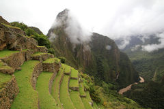 The  Inca terraces  of Machu Picchu and clouds Royalty Free Stock Images