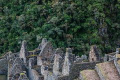 Inca town ruins and the jungle. Ancient stone ruins of an Inca town on the Inca Trail in the Andes mountains. Cusco. Peru. South America. No people stock image