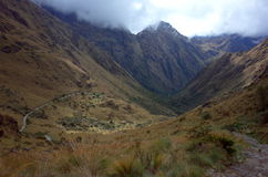 On the Inca Trail. A path descends into the valley on the Inca Trail stock images